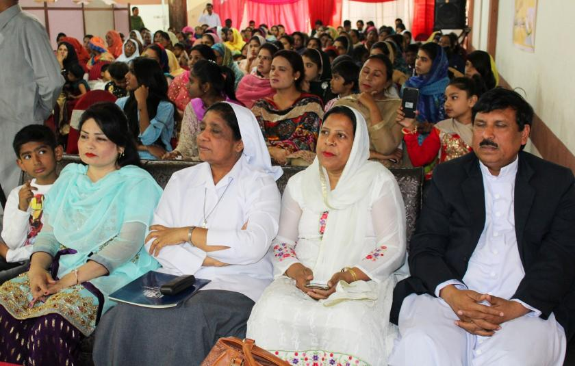 Photo of a group of Pakistani people sitting at an event