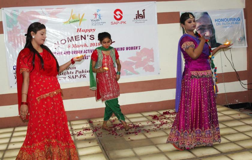 Photo of Pakistani women performing at Womens Day event