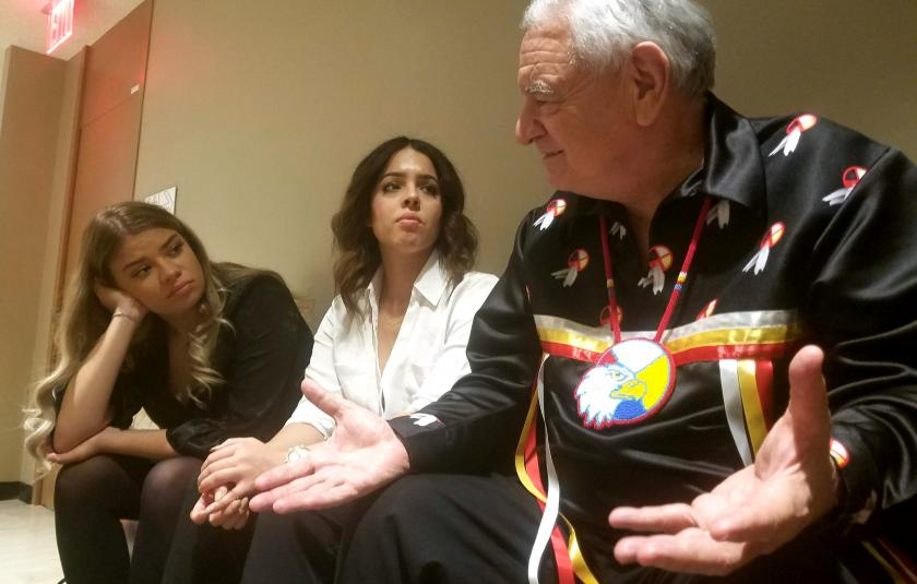 Emerald Stanton and Laila Galarsa with Indigenous Elder Chief Phil Lane, Jr.