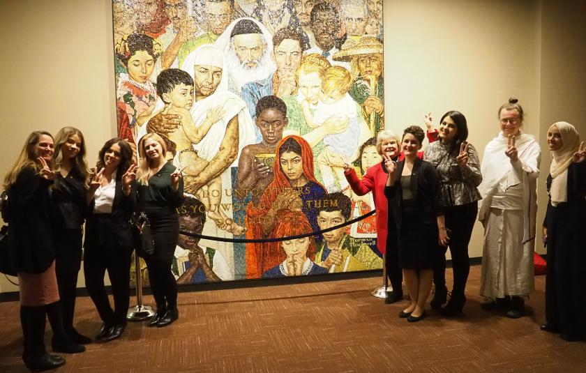 "URI leaders with a mosaic of the Normal Rockwell ""Golden Rule"" painting at the UN."