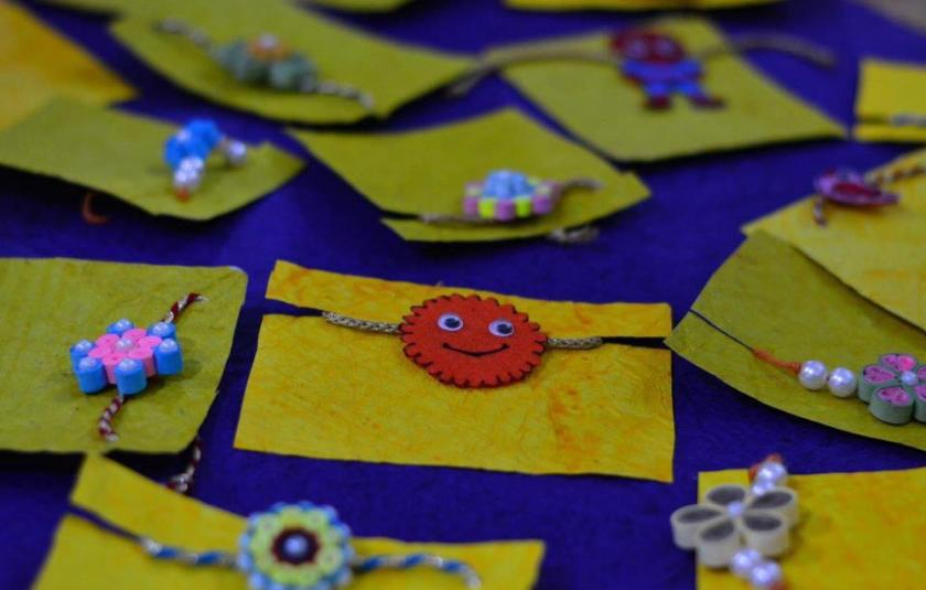 A photo of handmade Rakhis kept on a table.