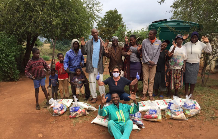 Photo: group gathers with food hampers