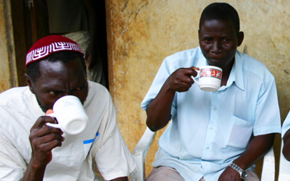two youth blacks drinking coffee
