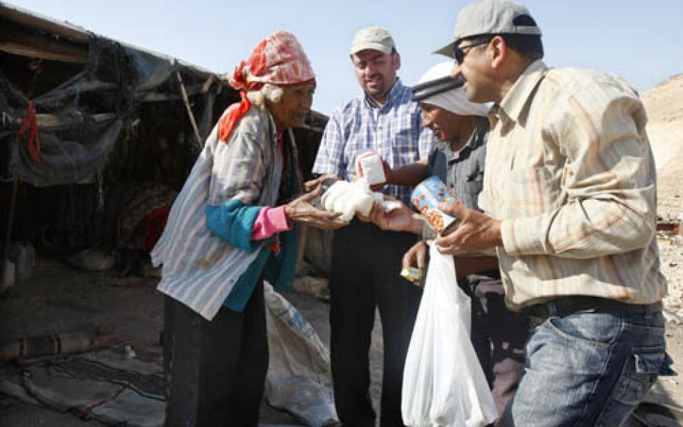 A_Palestinian_elderly_woman_recievs_food_and_clothes-_VFP_Relief_Project_for_Bedouins_in_Palestine-_6_September_2009.jpg