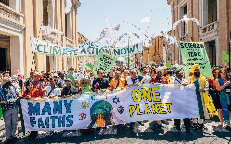 Reps from many faiths march for one planet in Rome