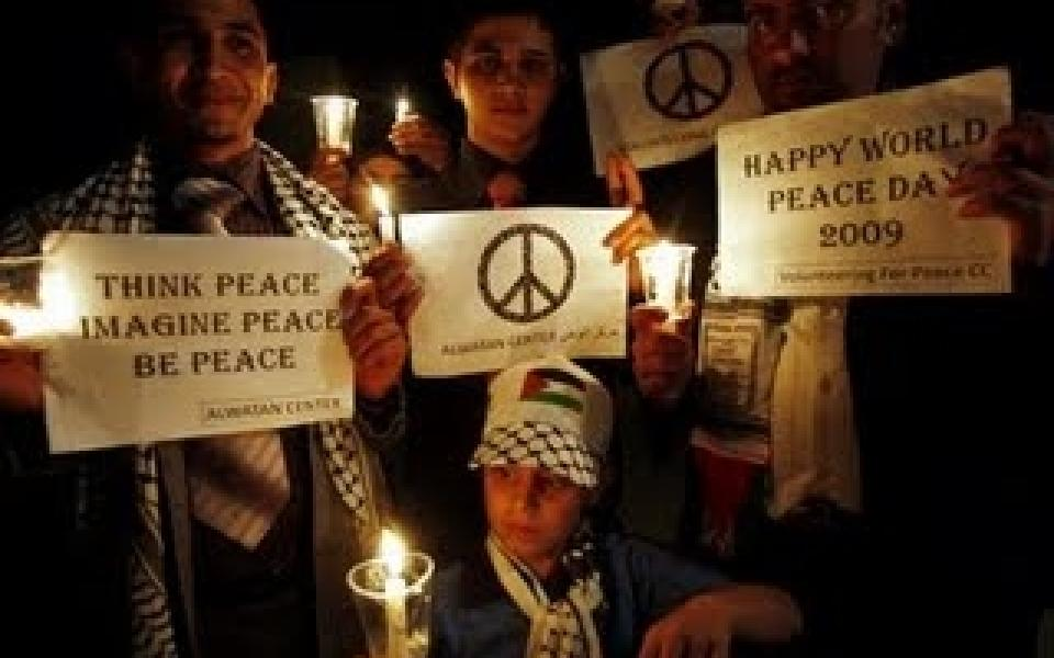 children holding peace signs in the west bank