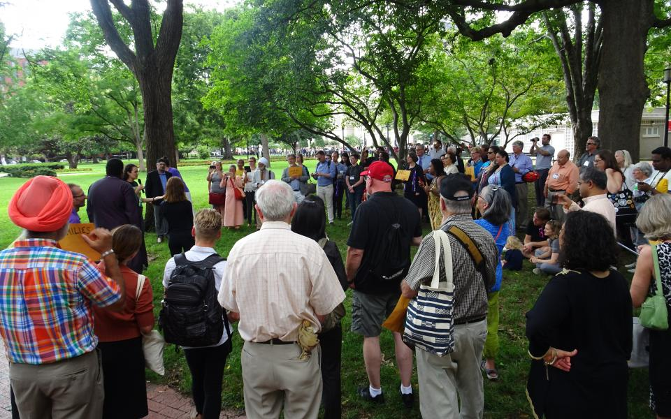 People gather for an Interfaith public action during Reimagining Interfaith