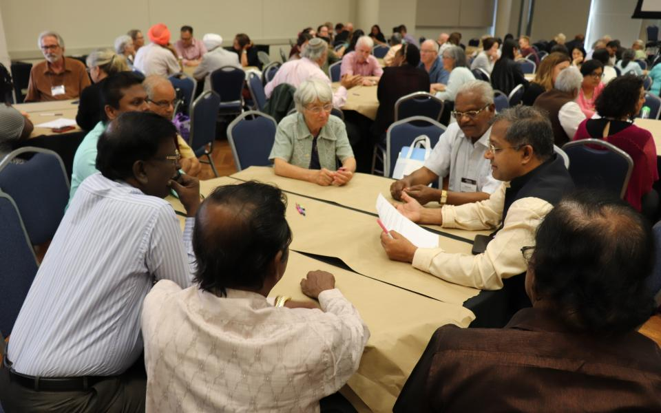 Participants participate in a World Cafe dialogue.