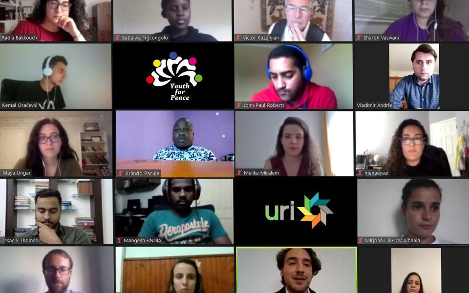 Photo: Screen shot of faces of young people in Zoom screens at the online event for International Youth Day